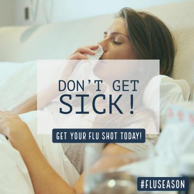 Don't get sick. Get the flu shot. A woman blows her nose.