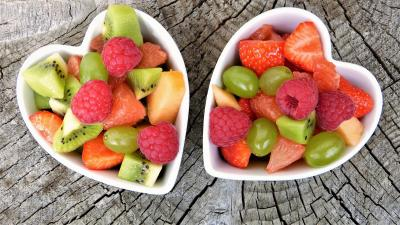 Two Heart Shaped Bowls of Healthy Fruit