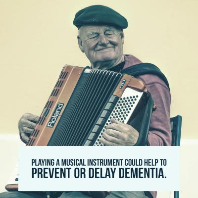 Older man plays a musical instrument called the accordion smiling with a statistic about dementia
