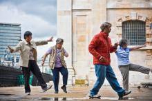 Elderly people doing tai chi outside